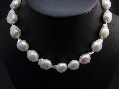 White Teardrop Shape Freshwater Baroque Pearl Necklace With A Silver Patterned Magnetic Clasp. Available in Store £920.00
