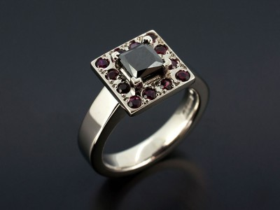 Square Black Diamond 0.70ct with Round Rubies in a Palladium Halo Design