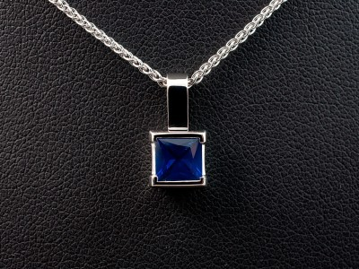 Square Cut Sapphire 1.01ct in a 18kt White Gold Half Rub Over Setting with Spiga Chain.