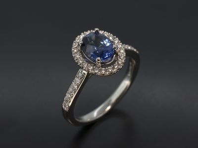Oval Cut Sapphire with Diamond Halo & Shoulder Design
