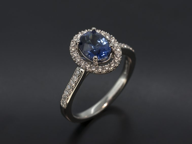 Oval Cut Sapphire with Diamond Halo & Shoulder Design