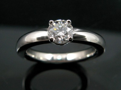 White Gold 18kt Halo Band Engagement Ring in a 4 Claw Setting with a 0.50ct G VS2 Round Brilliant Diamond