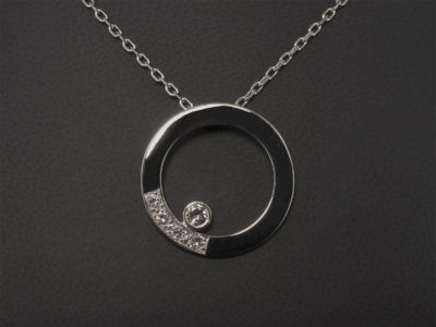 White Gold Rub Over & Pavé Set Diamond Circular Pendant.