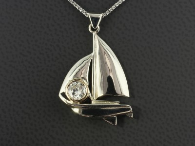 Yacht Design Pendant in 9kt White and Yellow Gold with a 0.44ct Round Brilliant Diamond.
