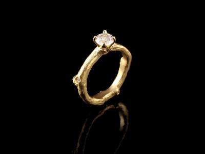 Yellow Gold 18kt Twig Engagement Ring with a 0.63ct F SI1 and 3 x 0.01ct F VS Round Brilliant Diamonds