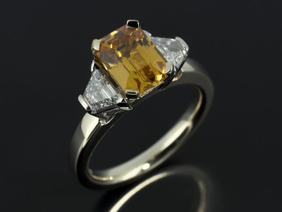 Emerald Cut Yellow Sapphire 1.80ct with 0.35ct Trapezium Cut Diamonds F VS in 9kt White and Yellow Gold Setting.
