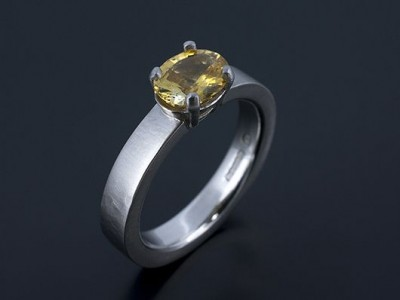 Oval Yellow Sapphire 1.10ct in a Palladium 4 Claw Setting with Brushed and Hammered Band.