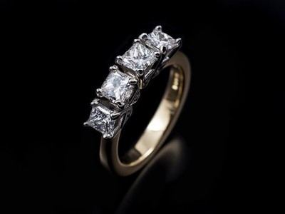 Princess Cut 1.46ct (4) D Colour VVS1 Clarity in Platinum Settings with an 18kt Yellow Gold Band.