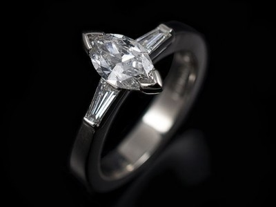 Platinum hand-made engagement ring. Marquise cut diamond 0.71ct, E Colour, SI2 Clarity, Excellent Polish, Very Good Symmetry, Nil Fluorescence with tapered baguettes 0.18ct (2) F colour SI clarity minimum