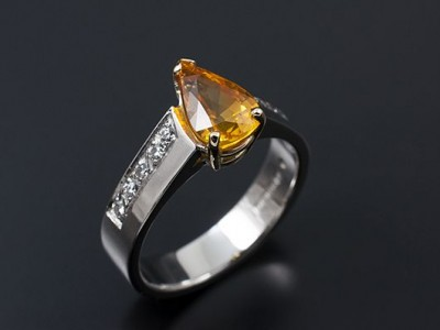 Pear Cut 1.87ct Yellow Sapphire with Round Brilliant Diamonds Pave Set into Shoulders. Hand Made in 18kt White Gold
