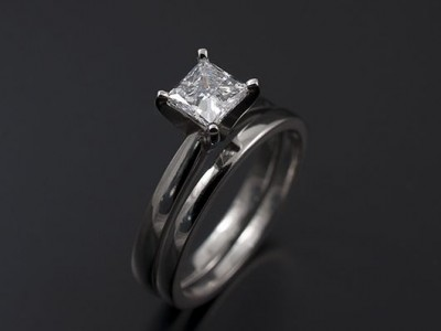 Princess Cut 0.63ct E Colour VS1 Clarity Excellent Polish and Excellent Symmetry in a 4 Claw Platinum Setting with Matching Wedding Ring.