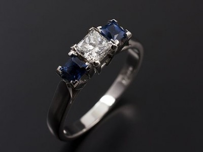 Princess Cut 0.40ct G VS1 with 2 x 0.25ct Square Sapphires in a Platinum 4 Claw Trilogy Setting