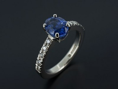 Oval Ceylonese Sapphire 2.13ct with Round Brilliant Diamonds Claw Set into Band. Hand Made in Palladium.