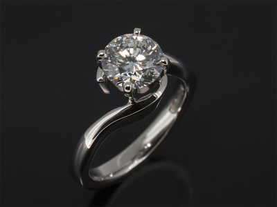 Round Brilliant Cut Diamond. 1.23ct, E Colour, VS2 Clarity Claw Set in Platinum in a Twist Design