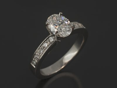Oval Cut Diamond, 1.08ct, D Colour, VS2 Clarity, Four Claw Set in Platinum with Round Brilliant Cut Diamond, 0.20ct (10) Pavé Set Shoulder