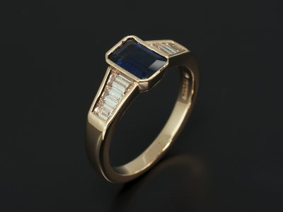 18kt Red Gold Rub-over Set Emerald Sapphire 0.95ct & Channel Set Baguette Diamond 0.61ct (6) Ring Design