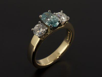 Platinum & 18kt Yellow Gold Oval Cut Blue Diamond 0.89ct and Round Brilliant Cut Diamond 0.39 (2) Trilogy Design.