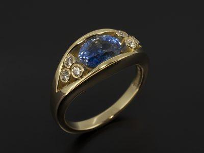 18kt Yellow Gold Tension Set Oval Sapphire 2.09ct & Rub-over Set Round Brilliant Cut Diamond 0.12ct (6) Ring Design