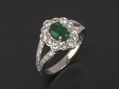 Platinum Claw Set Oval Emerald 0.73ct with Rub-over Set Round Brilliant Cut Diamond Halo 0.55ct (12) & Pavé Set Round Brilliant Cut Diamond 0.13ct (18) Split Shoulder Ring Design