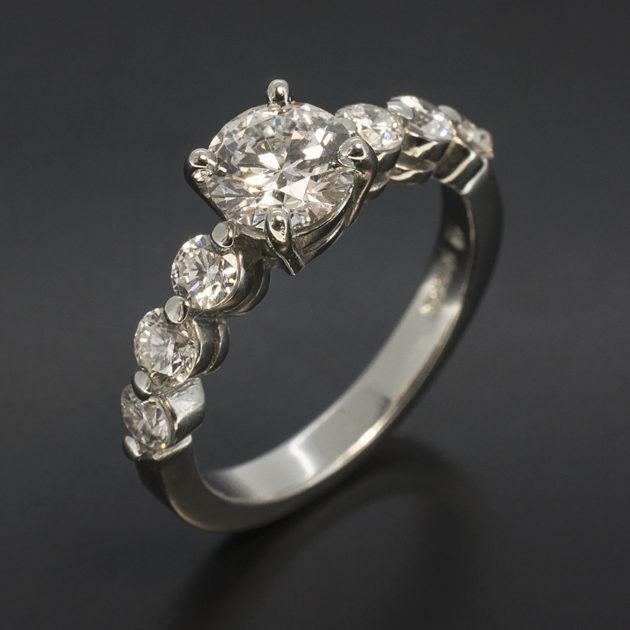 Round brilliant cut diamond claw set platinum engagement ring, 7 diamond platinum ring, 7 round brilliant cut diamond ring, claw set diamond and platinum engagement ring