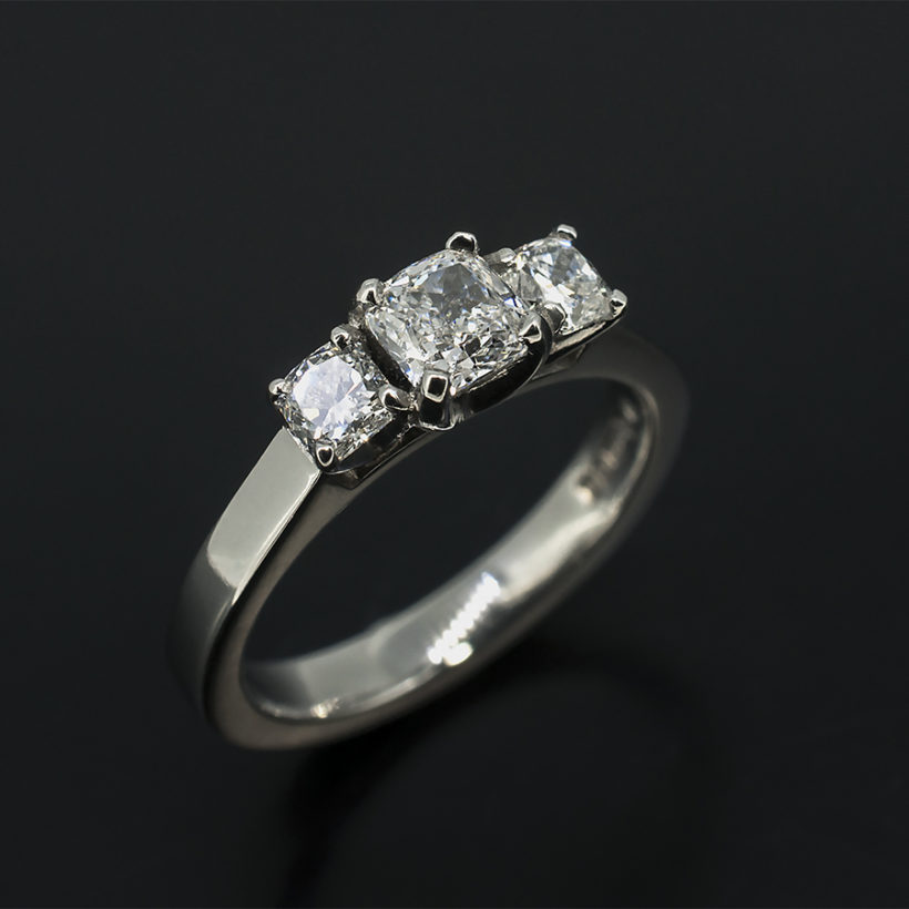 Cushion Cut 0.51ct D Colour VS2 Clarity EXVG with Cushion Cut Side Diamonds 0.40ct Total in a Platinum Claw Set Trilogy Design Engagement Ring