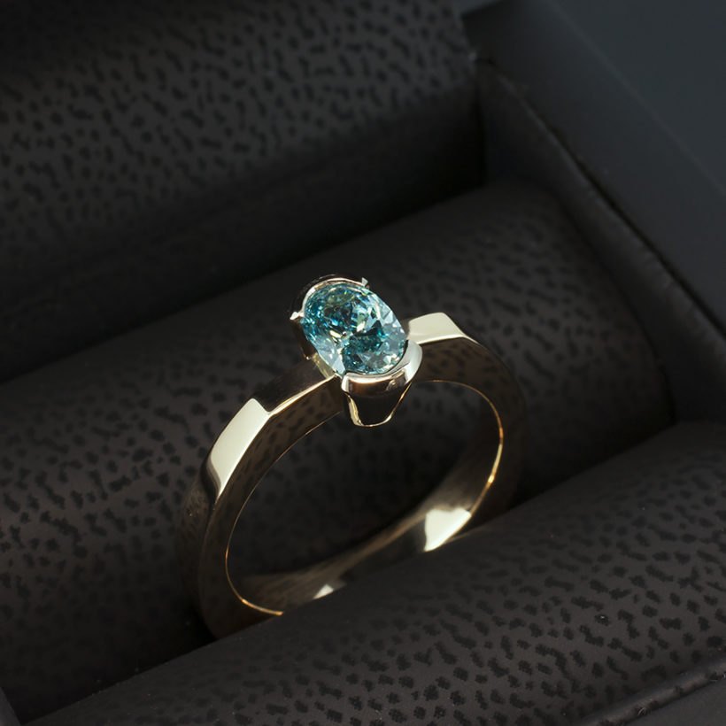 contemporary design diamond ring, red and white gold mix ring, oval blue diamond ring, bespoke rings designed and handmade in scotland