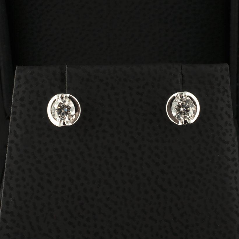 18 karat white gold diamond claw set earrings