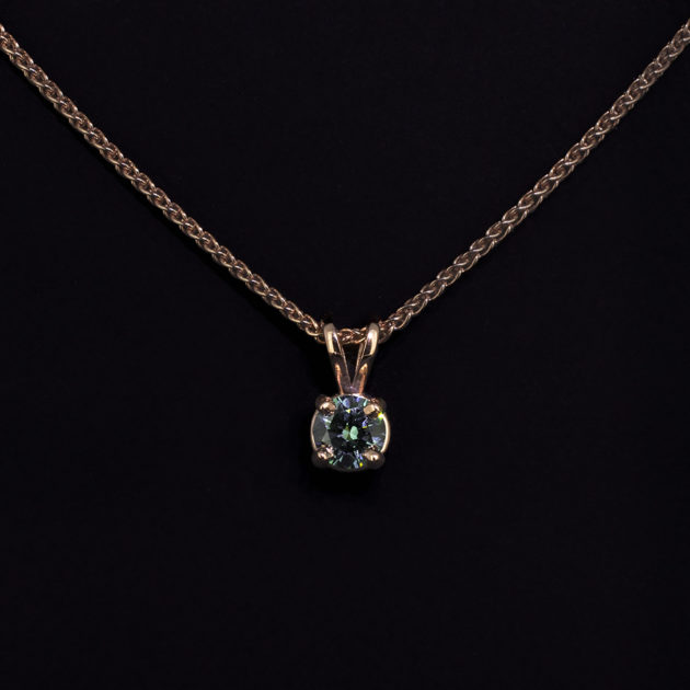 9kt Rose Gold Claw Set Pendant. Round Brilliant Cut Blue Diamond, 0.37ct, Spiga Chain
