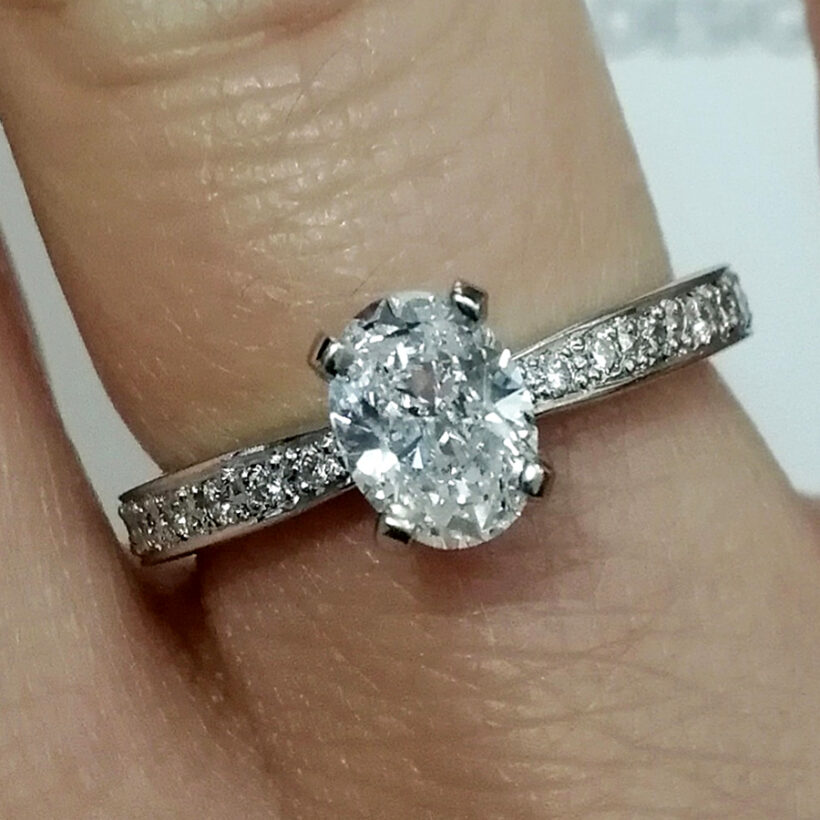Oval Cut Diamond 0.71ct Engagement Ring in Platinum 4 Claw Setting With Pavé Shoulders