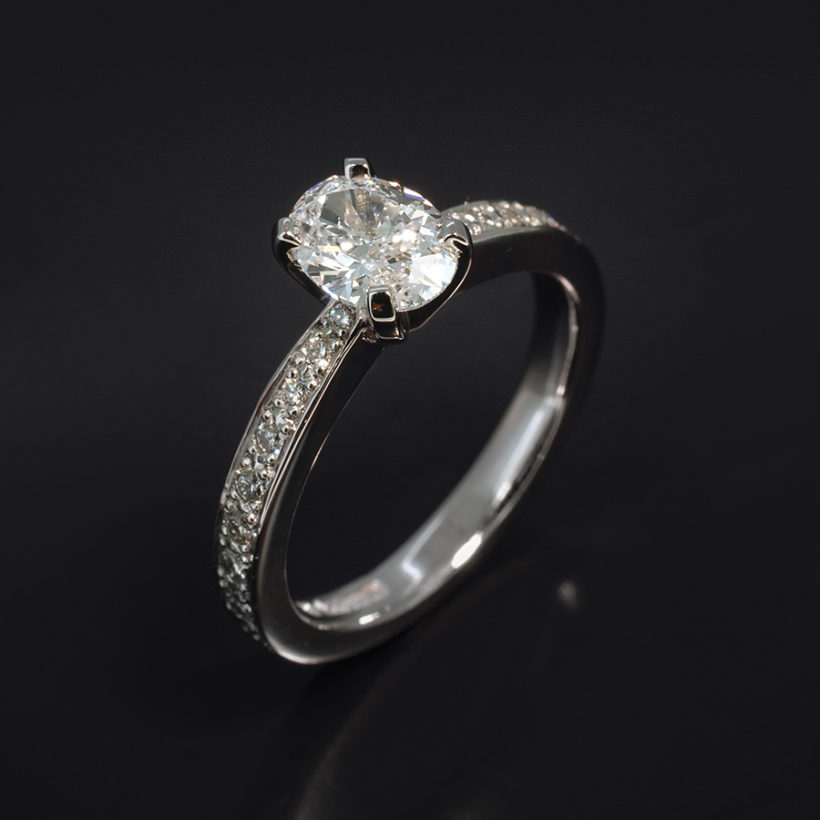 oval cut diamond engagement ring, oval cut diamond and pave ring, claw set diamond ring with pave, platinum and diamond engagement ring glasgow