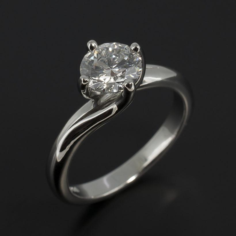 Claw Set 0.90ct Diamond Solitaire Twist Design Platinum Engagement Ring