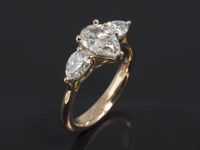 18kt Red Gold Trilogy Design Pear Shape Diamond, 0.90ct, F Colour, VS2 Clarity. Excellent Polish, Excellent Symmetry. Pear Shape Diamonds, 0.60ct (2), F Colour VS Clarity Minimum