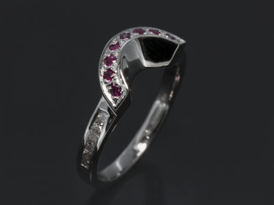 18kt White Gold Fitted Pavé & Channel Set Design. Round Brilliant Cut Rubies, Approximately 0.16ct (8). Princess Cut Diamonds, 0.18ct (12), F G Colour, SI Clarity.