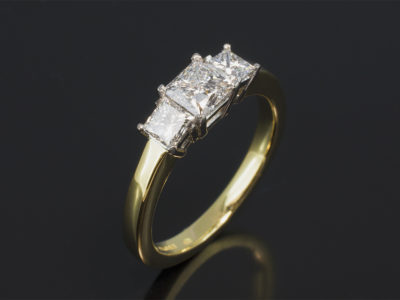18kt Yellow Gold & Platinum Claw Set Trilogy Design. Princess Cut Diamonds 0.70ct, D Colour, SI1 Clarity Princess Cut Diamonds, 0.62ct (2). F Colour, VS Clarity