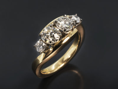 18kt Yellow Gold & Platinum Twist Design. Approximately 0.70ct. IJ Colour, SI Clarity. Approximately 0.60ct. GH Colour, I Clarity. pproximately 0.30ct (2). EF Col VS Clarity