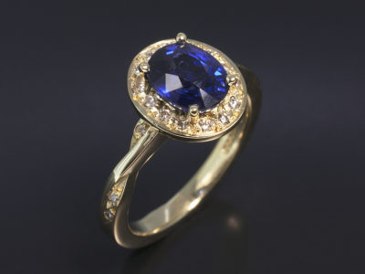 18kt Yellow Gold Oval Sapphire 1.56ct with Round Brilliant Cut Diamond 0.12ct (20) Halo & Twist Shoulder
