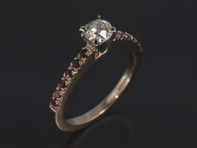 9kt RG Claw Set Design. Cust Own 057CT Rbc Diamond, HI, I1. Round Garnet Shoulder, 1.8mm