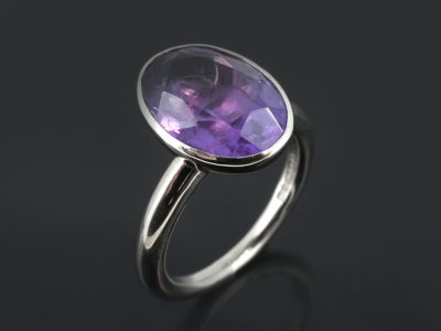 9kt White Gold Rub Over Set Halo Shank Design Oval Cut Amethyst, Approximately 6ct.