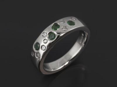 9kt White Gold Scattered Secret Set Design Round Brilliant Cut Diamonds, 0.16ct (8) Round Brilliant Cut Emeralds, 2.4mm -2.7mm (4).