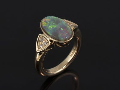 9kt Yellow Gold Rub Over and Pavé Set Dress Ring. Opal 13 x 7.2mm with Round Brilliant Cuts 0.09 total