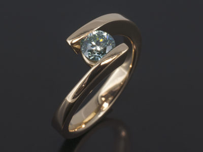 9kt Yellow Gold Tension Set Twist Design Round Brilliant Cut Blue Diamond 0.62ct