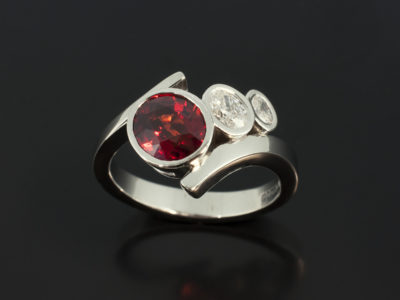 Blood Orange Sapphire 2.64ct with Oval Cut Diamonds 0.32 and 0.13ct F Colour VS Clarity in a Platinum Rub Over Set Twist Band Design