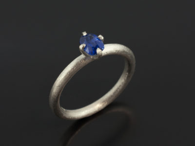 Cushion Cut Sapphire 0.62ct in a Platinum 4 Claw NSEW Setting with a Brushed Finish