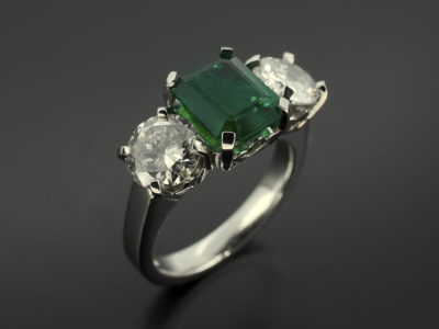 Emerald 1.77ct with Round Brilliant Cut Diamonds 1.03ct and 0.89ct F SI in a Platinum 4 Claw Trilogy design with Leaf Detail
