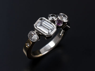 Emerald Cut 0.63ct D VVS2 in a 18kt White Gold and Yellow Gold Asymmetrical Rub Over Setting with Round Brilliant, Oval and Pink Sapphire Precious Stones