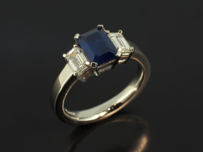 Emerald Cut Sapphire 1.05ct with Emerald Cut Diamonds 0.64ct (2) F Colour VS Clarity Min in a Platinum Claw Set Trilogy Design