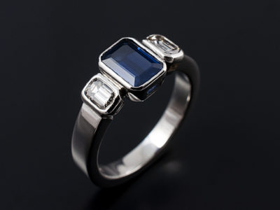 Emerald Cut Sapphire trilogy ring with Emerald cut diamond side stones