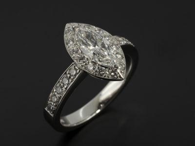 Marquise cut diamond, 0.7ct, E colour VS2 Platinum design with pavè set round brilliant cut diamond shoulders and halo