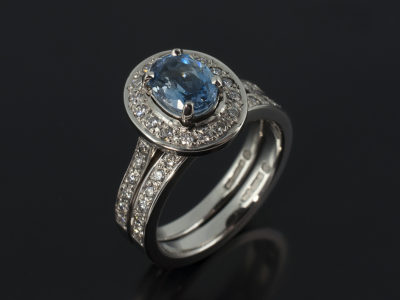 Oval Cut Aquamarine 0.7ct in Palladium Halo with Fitted Wedding Ring