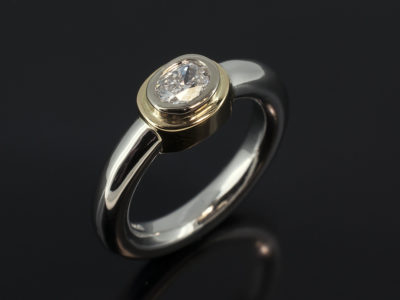 Oval Cut Diamond 0.40ct F Colour VVS Clarity in an 18kt Yellow Rub Over Setting with Platinum Halo Shaped Band
